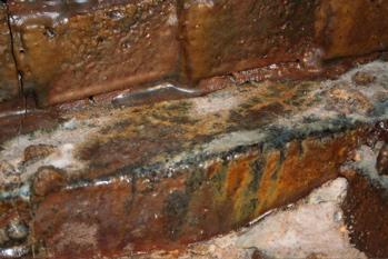 Brick glazed by melting floor sand